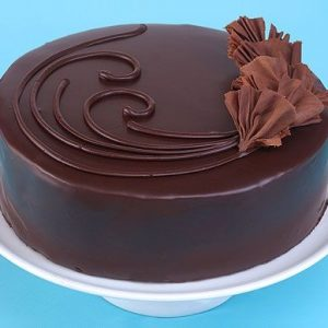 Chocolate cake with fresh cream and topping chocolate