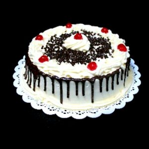 Black Forest Cake with fresh cream, topping cherries and chocolate