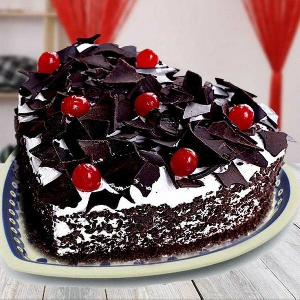 Heart shape black forest cake topping with cherries at cakejee.com