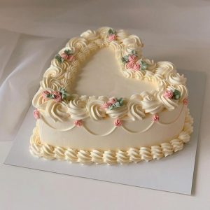 Heart shape creamy butter scotch cake for anniversary