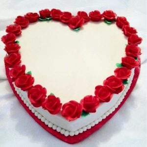 Heart shape flowery white forest cake