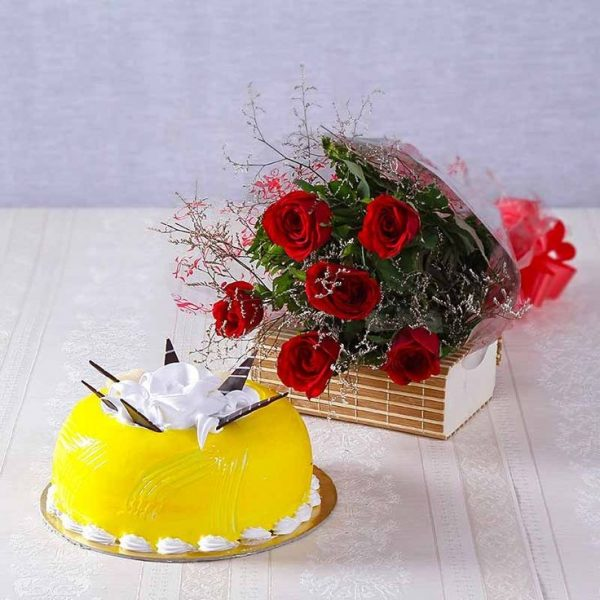 Pineapple cake with 6 red roses bunch at cakejee.com