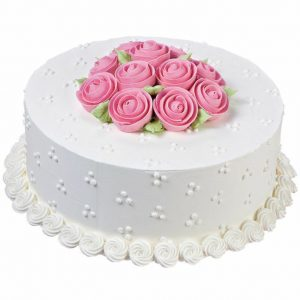Vanilla cake in white and topping with pink roses