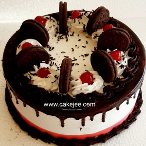 Oreo cake with fresh Cream and topping chocolate Oreo biscuits and cherries